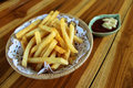 French fries american english or chips finger chips or fried potatoes are batons of deep fried potato in the united Royalty Free Stock Photo