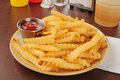 French fries and catsup a plate of Royalty Free Stock Photos