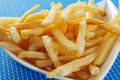 French fries closeup of a bowl with appetizing on a set table Royalty Free Stock Photography