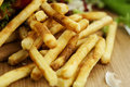 French fries crispy on a wooden background Royalty Free Stock Photos