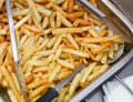 French fries fresh cooked. Restaurant deep fryer Royalty Free Stock Photo