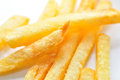 French fries macro on white background Royalty Free Stock Images