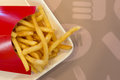 French fries in a red carton box on the white plate Royalty Free Stock Photo