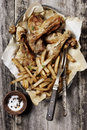 French fries and roasted chicken in a bowl Royalty Free Stock Photo