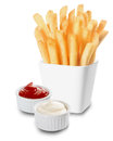 French fries served with mayo and ketchup crisp golden or fried potato chips individual containers of creamy mayonnaise tomato on Stock Photo