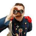 French general with beautiful mustache looking through binocular binoculars isolated on white Stock Photos