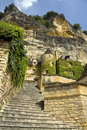 French hillside town looking up steps towards a turret and cliffs in a Stock Photos