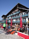 French holiday skiers relax at an outdoor restaurant les gets france mar during the annual winter school on mar in avoriaz Stock Photo