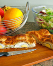 A french home made boiled egg pie on a wooden board with a side salad and fruit Stock Photos