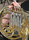 French horn detail of a musicians fingers playing a Royalty Free Stock Images