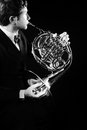 French horn player Royalty Free Stock Photo