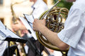 French horn player musician playing a in orchestra Stock Image