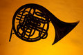 French Horn Silhouette Isolated on Yellow Royalty Free Stock Photo