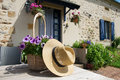 French house with flowers in garden the and straw hat Royalty Free Stock Photos