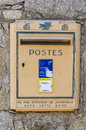 French letter box on a stonewall in sant antonino corsica france Stock Photo