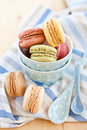 French macaroons in vintage blue cups Stock Image