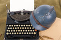 French military helmet of the First World War with old typewrite Royalty Free Stock Photo
