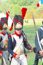 French napoleonic soldiers reenactors march moscow region september a they hold guns they wear hats decorated by red plumage one Stock Photos