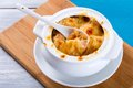 French onion gratin soup in a white pot, close-up Royalty Free Stock Photo