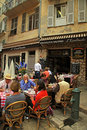 French outdoor cafe in the old town nice france may people having lunch at beautiful largest resort and tourist on Stock Photos