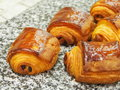 French pain au chocolat, marble surface Royalty Free Stock Photo