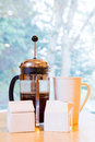 French press coffee is being made in a along with cream and sugar on the kitchen counter early in the morning Royalty Free Stock Photo
