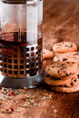 French press with hot tea and fresh baked cookies Stock Photos