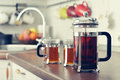 French press with tea and cups Royalty Free Stock Photo