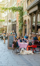 French restaurant outdoor with customers waiting enjoying food w Royalty Free Stock Photo