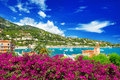 French reviera view of luxury resort near nice and bay villefranche sur mer and monaco seafront landscape with azalea flowers Royalty Free Stock Photography