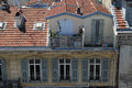 French rooftops nice france old vintage with shutter windows and balconies Royalty Free Stock Images