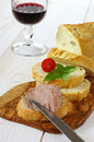French Snack: French maize bread, pate and glass of red wine Royalty Free Stock Photo