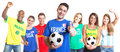 French soccer fan with football showing thumb up with other fans Royalty Free Stock Photo