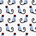 French style cat seamless pattern on polka dots background. Cute cartoon sitting cat vector illustration.