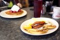 French toast, bacon, and eggs Royalty Free Stock Photo