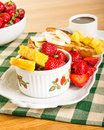 French toast with fruit and coffee strawberries pineapple bananas Stock Images