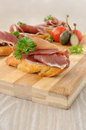 French toast with jamon slices of bread spanish serrano on a wooden board Stock Photo