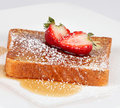 French toast with powdered sugar and a strawberry Royalty Free Stock Photos