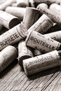 French wine corks on winemaker old bottling table used drinking from opened bottles with generic wording naming local at the Royalty Free Stock Images