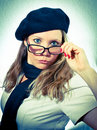 French woman pulling glasses down Stock Image
