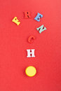 FRENCH word on red background composed from colorful abc alphabet block wooden letters, copy space for ad text. Learning Royalty Free Stock Photo