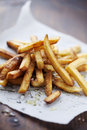 Frensh fries golden crispy french with salt and herbs Royalty Free Stock Photo