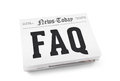 Frequently asked questions faq word writing on the front page of newspaper stack isolated on white background Royalty Free Stock Images