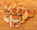 Fresh appetizing sweet rolls on wooden board top view Royalty Free Stock Image