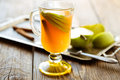 Fresh apple juice with apple slices and cinnamon stick for winter christmas Stock Photo