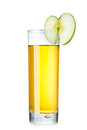 Fresh apple juice isolated in highball glass decorated with green slice Royalty Free Stock Image