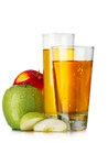 Fresh apple juices in highball glasses with red and green apples Royalty Free Stock Photography