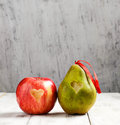 Fresh apple and pear with heart for valentine day ripe Royalty Free Stock Photography
