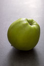 Fresh apple ripe green on table backlit Royalty Free Stock Images