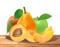 Fresh apricot, peach, apple and pear on wooden plate isolated on Royalty Free Stock Photo